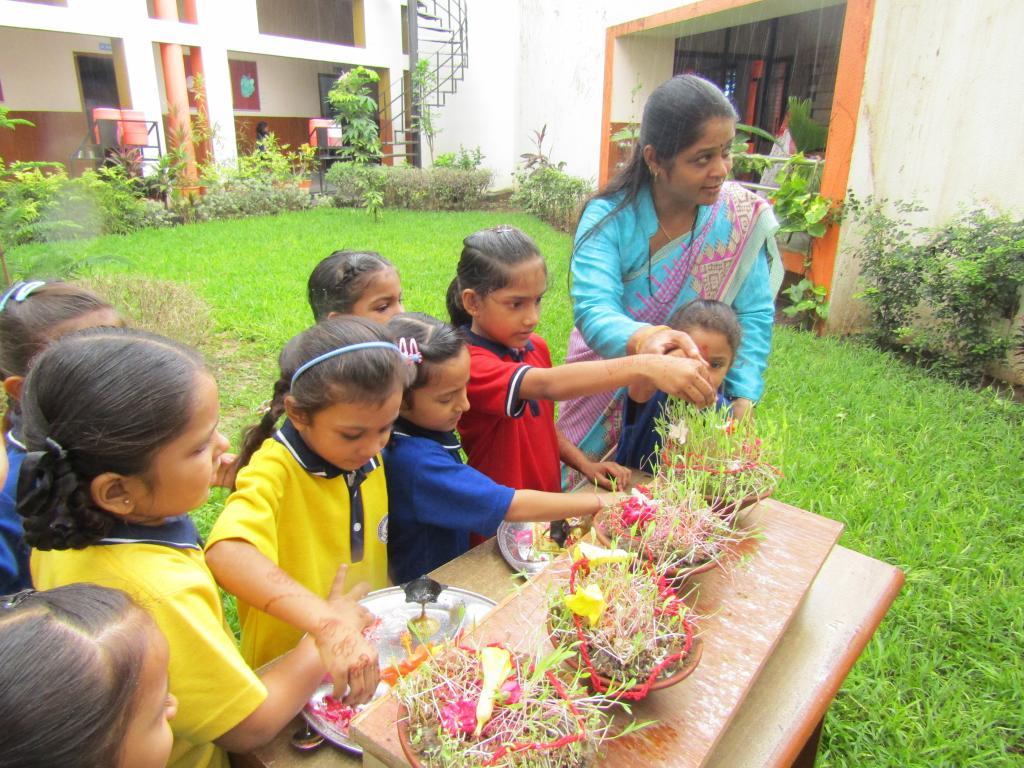 kids enjoying gaurivrat pooja